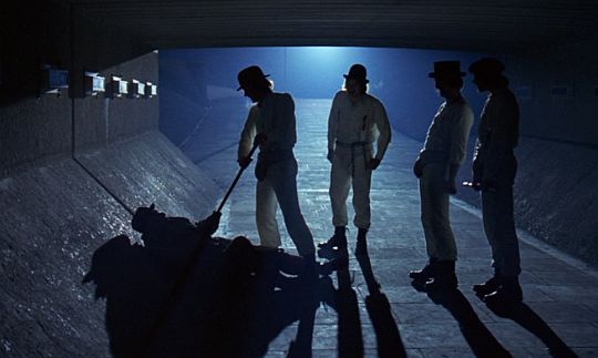 The droogs assaulting a drunken homeless man in noire-ish lighting.