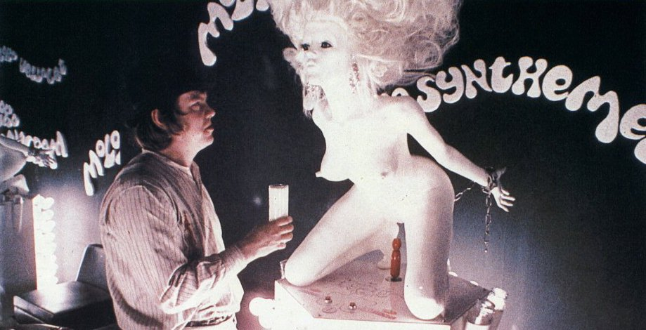 Dim getting a glass of milk from naked women scuptures.
