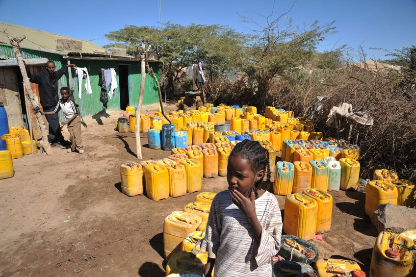 44456954 - one of the largest refugee camps for african refugees and displaced people on the outskirts of hargeisa under auspices of un. point of delivery of drinking water.